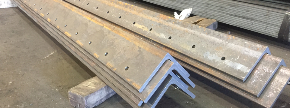 Structural_Steel_Angles_Fabricated_to_exact_Specifications - NYC_Structural_Steel_Fabricators - Punching_Fabrication