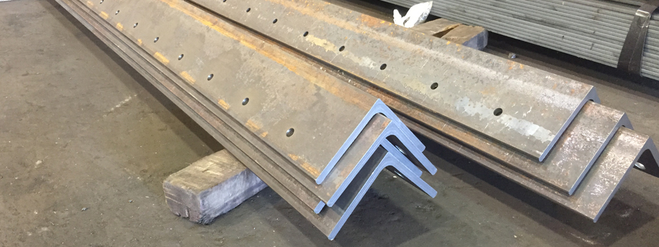 Structural_Steel_Angles_Fabricated_holes - Custom_Steel_Fabricators_A36_Angle_Iron - Steel_Suppliers_NYC
